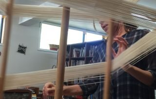 woman working on her weaving project